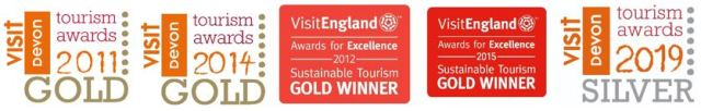 Award logos for Wheatland Farm's Devon eco lodges