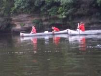 2 canoes paddling
