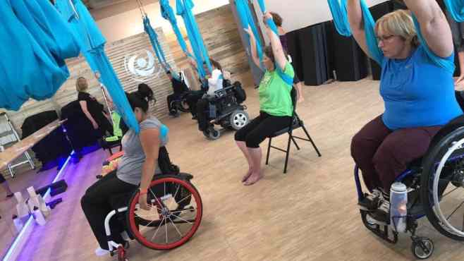 Adaptive Aerial Yoga Allows Wheelchair Users to FlyWheel:Life