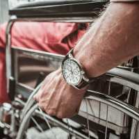 Close up of big watch on the wrist of the disabled man