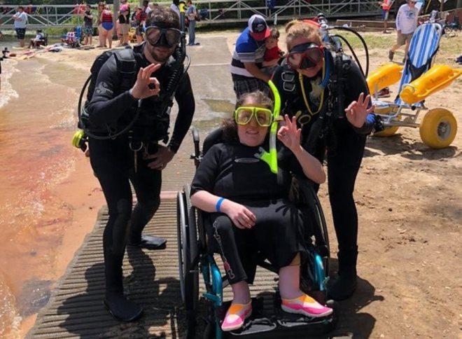 woman in wheelchair in scuba gear