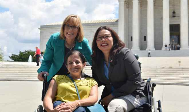 Senator Duckworth with two women