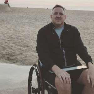 Stefan Freeman sitting in his wheelchair at the beach.