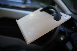 Notebook Wheeldesk car desk mounted on a car steering wheel.