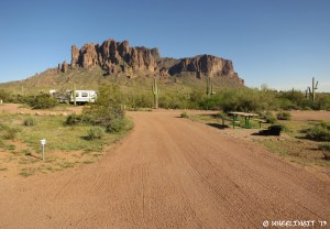 View of pull-through in overflow campground. This is site #78. RV in site #98 behind.