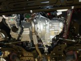 This is the engine/transmission assembly viewed from below, shown now with the exhaust system attached.