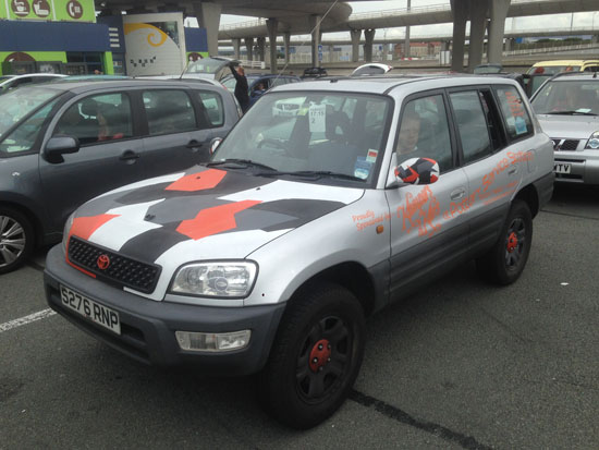 Awaiting the ferry back to England; the Toyota was travel-stained and had suffered a vandalised quarter window, but was still running perfectly and had helped to raise much money for the Dementia UK charity. (Photo courtesy Niall Brown).