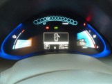 To the left side of the dash display is a battery temperature gauge, towards the top is the 'instant' indicator of power consumption or regeneration, and on the right hand side is the vital gauge showing battery state and remaining mileage range.
