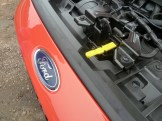 What a good idea… No need to fumble around trying to locate the engine bay's bonnet release handle on this Fiesta; it is finished in bright yellow, and very easy to find when required. Well done Ford!
