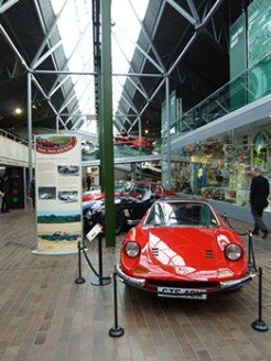 Within the 'Road, Race and Rally' section of the National Motor Museum's 'Chequered History' display are 'cars for sport' and 'sporting cars'. In the foreground here is a 1974 Ferrari Dino (ahead of a 1965 AC Cobra and a 1969 Jensen Interceptor).