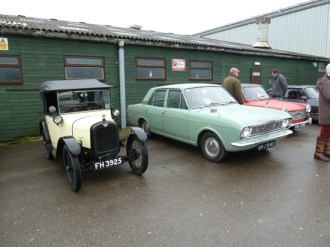 For many enthusiasts attending the Show, the car park was well worth exploring, as the event attracted a large number of diverse classics, including this Austin Seven Chummy, the smart Ford Cortina Mark II alongside it, and the Austin A40 Farina on the other side of it.