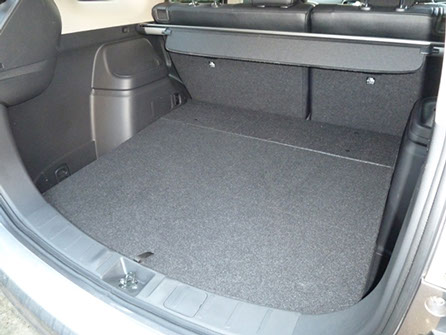 Even with the rear seats in use, there's a decent sized, flat-floored load area, plus a multitude of smaller compartments (including cup holders) in the 'boot'.