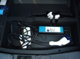 The PHEV's charging equipment is stored in a separate compartment beneath the main floor of the luggage compartment.