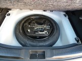 The 'space saver' spare wheel lives in its own well pressed into the car's structure, beneath the floor of the boot.