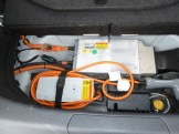 The charging apparatus is stored in its own compartment beneath the normal boot's floor, at the back of the vehicle.