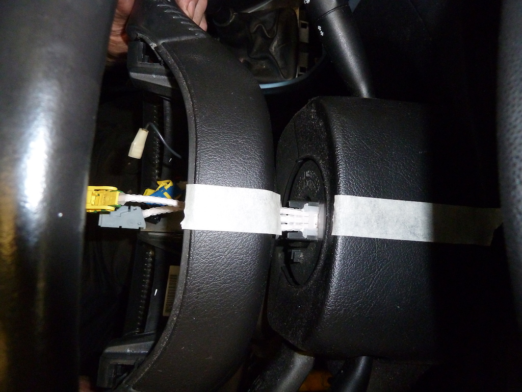 Masking tape can be used to mark the position of the steering wheel, prior to removal.