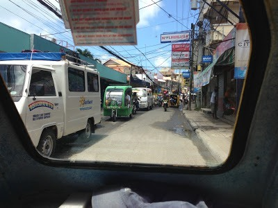 Main road in Boracay from the pedicab, full of cars philippines