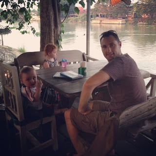 family sitting at restaurant by the river in ayutthaya