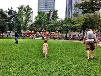 KLCC playground in the distance with kids Kuala Lumpur