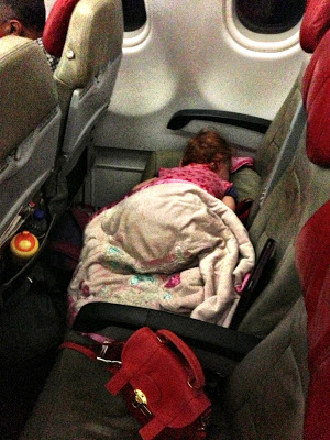 S sleeping across seats on air asia flight to melbourne