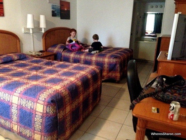 2 queen beds and furniture in room at travelodge clearwater motel chains usa