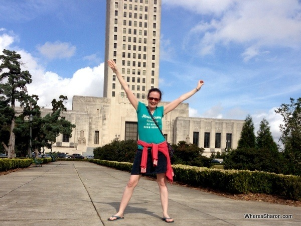 person standing in front of Louisiana State Capitol building