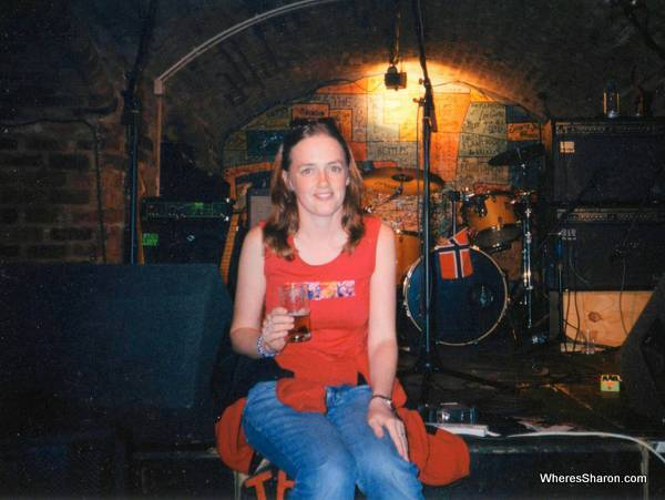 Sitting on a stage drinking beer in the cavern club liverpool