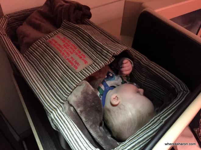 Baby takes a nap in Etihad business class A330