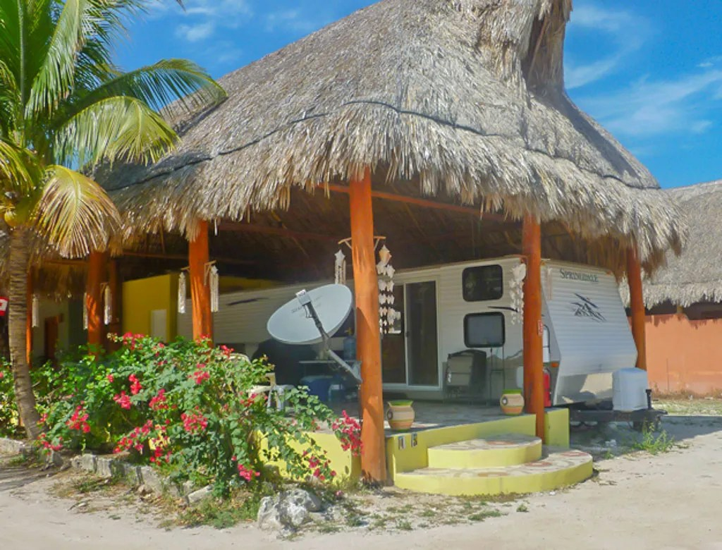 Paamul Home Consisting of an RV Shaded by a Palapa