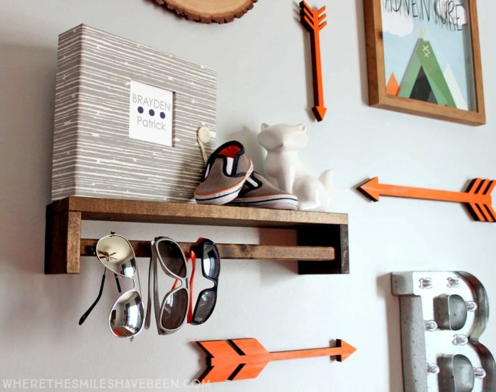 LOVE this mini gallery wall in a baby's room! That shelf is great! Take a tour of this navy & orange modern woodland nursery! | Where The Smiles Have Been