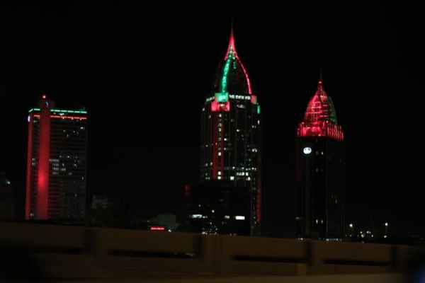 Mobile Alabama skyline lit up in red and green