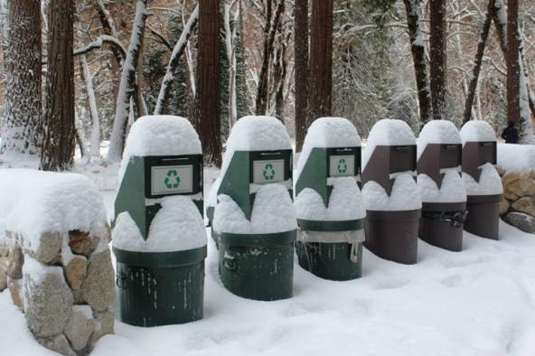 Snow piling on trash cans