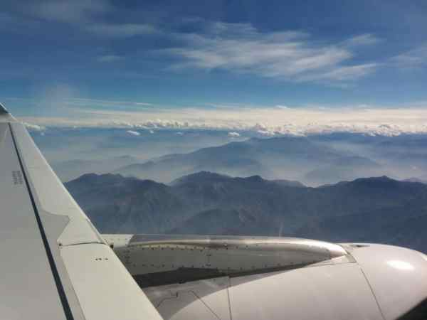 View of Andes on the way to Cusco through airplane window