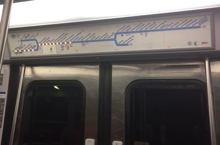 Metro map on top of doors in Paris metro