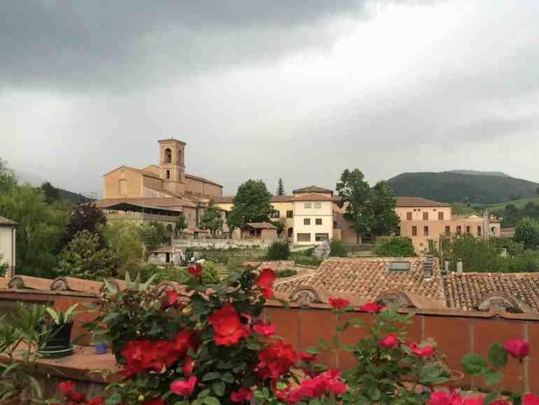 Church bell tower and storm clouds in Italy