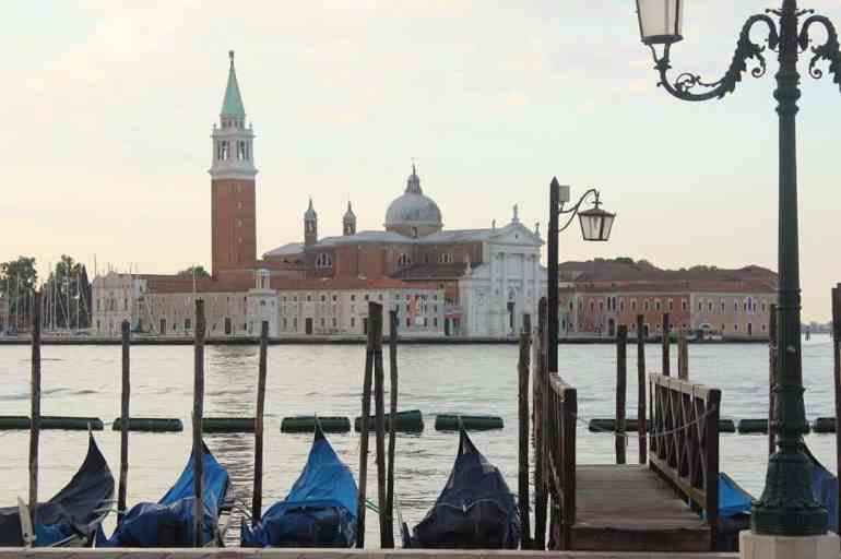 Eastern Europe Itinerary - Gondolas along the canal in venice
