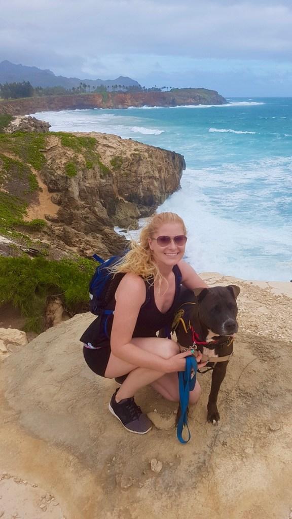 Hiking the Maha'ulepu Heritage Trail with a shelter dog.