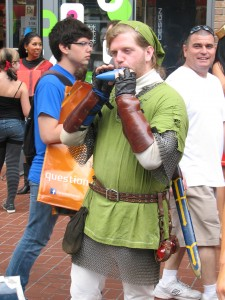 Link playing the Ocarina of Time in the Gaslamp.
