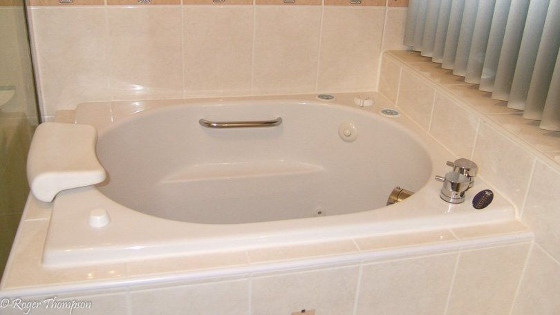 Oronsay deep soaking bath built in with tiled panels