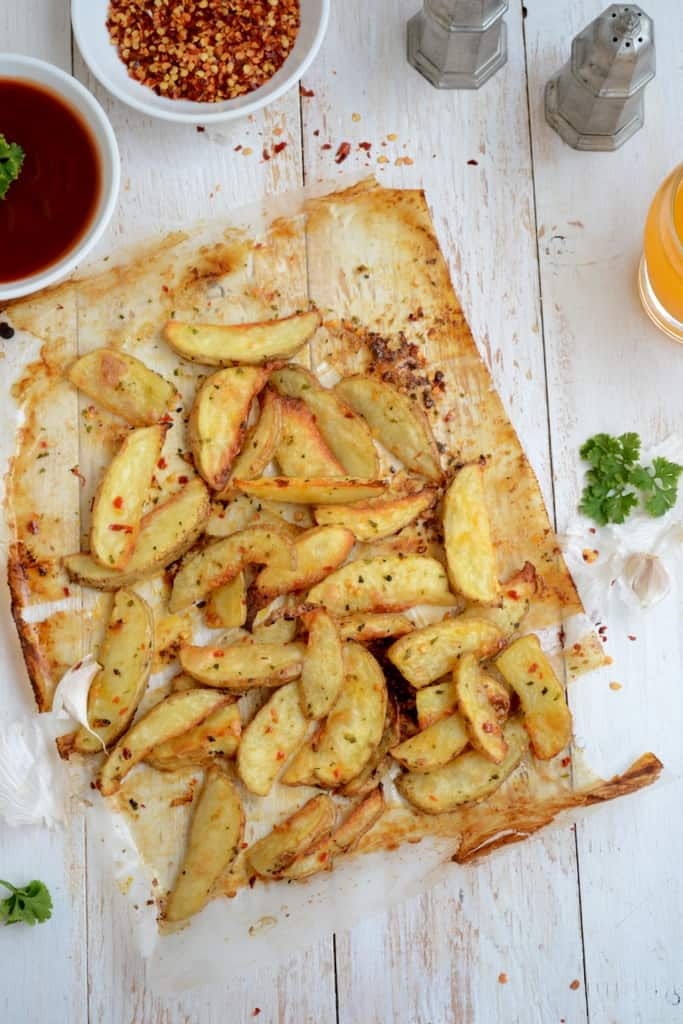 Crispy Herb Garlic Potato Wedges is an easy and quick to make snack option. Kids love it and so do grown ups. Here is the recipe.