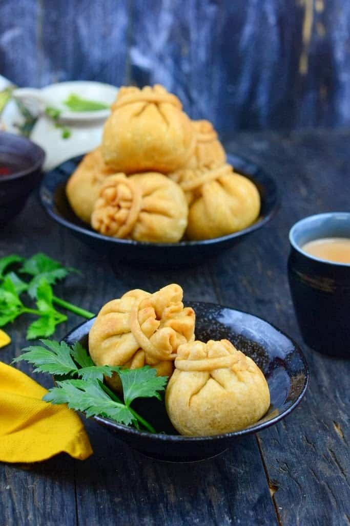 Aloo Matar ki Potli is a delicious Indian snack with a samosa like outer covering, and delicious potato and peas filling inside. It's shaped in the form of a small purse