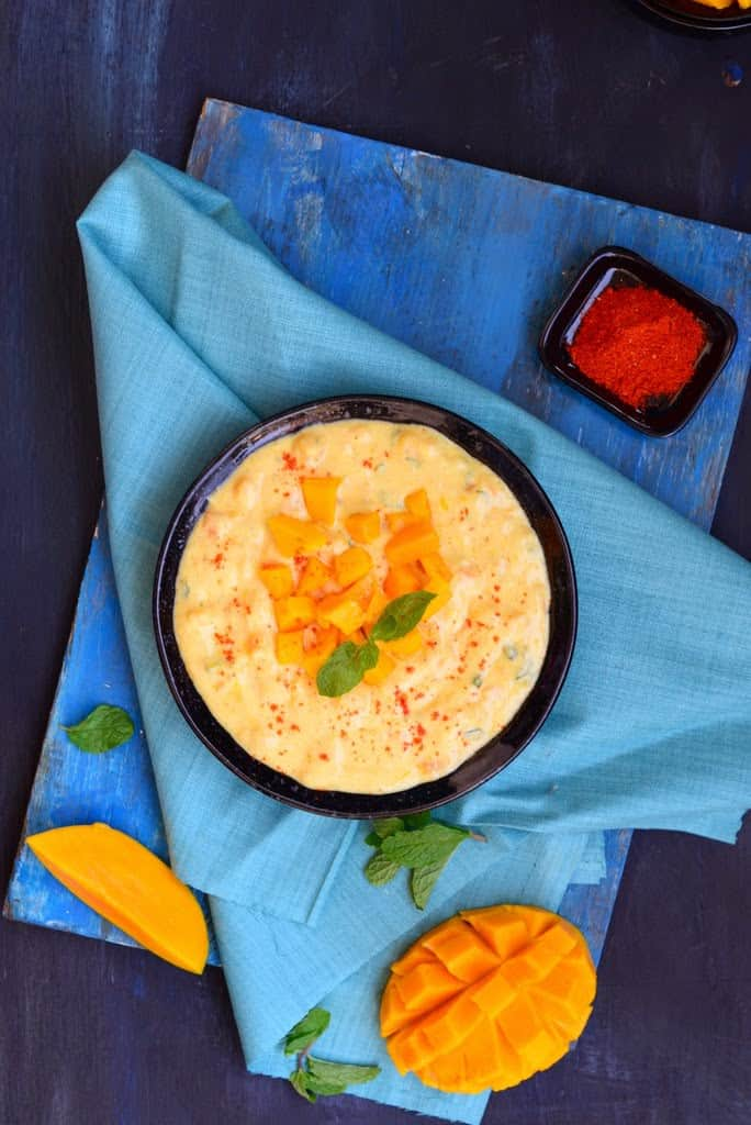 Mango Mint Raita is a delicious curd based accompaniment which goes very well with any meals. Raw mango and mint makes this raita very special.