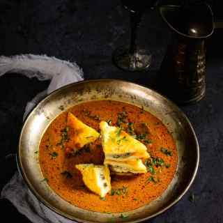 Paneer pasanda comprises of paneer triangles that are stuffed with a rich khoya and dry fruit mixture and then shallow fried and added to a thick, creamy, tomato based gravy. This mildly spiced gravy can be enjoyed with just white rice or as an accompaniment to rotis and Naans.