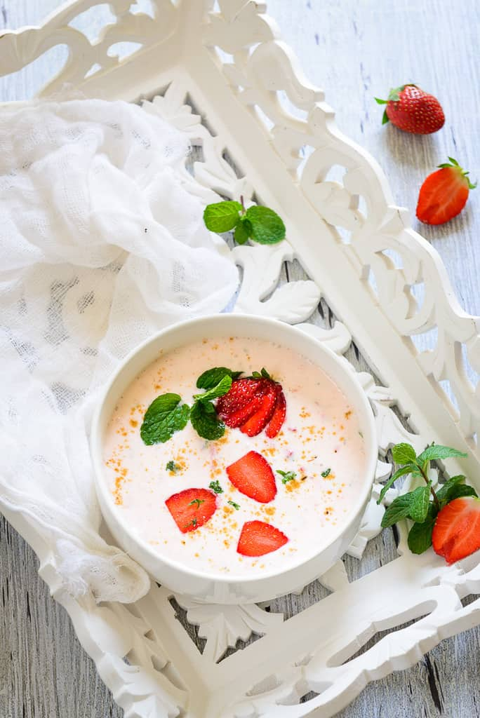 Strawberry Raita is a spicy and tangy accompaniment and can take any Indian style meal to a next level.