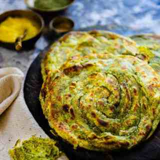 Pudina Laccha Paratha is a flaky Indian bread flavoured with dry mint powder.