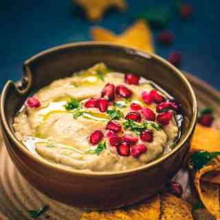Baba Ganoush is basically a Levantine dish assembled by mixing tahini, eggplant and olive oil. It is served with Pita Bread as a starter.