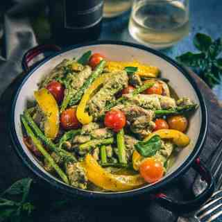 One Pot Pesto Chicken is a beautiful dish made using cherry tomatoes, bell peppers, boneless chicken and of course Basil Pesto. Serve it hot with bread.