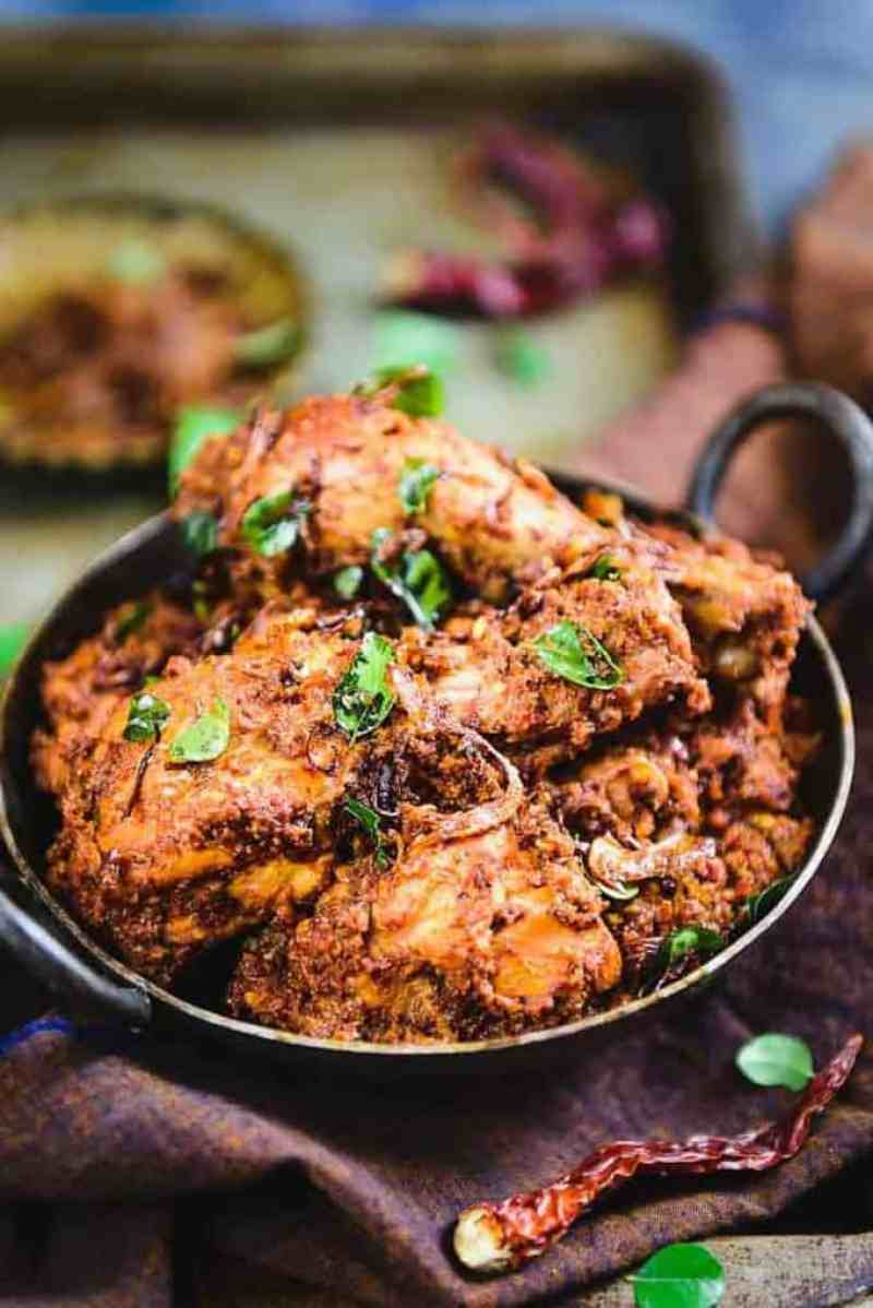Mangalorean Chicken Sukka is a dry dish made using fresh chicken, masalas, grated fresh coconut and it is generously tempered using ghee as well as onions.