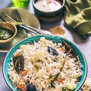 Veg Pulao is delicious medley of rice and vegetables. It is very simple and easy to make and pairs perfectly with any raita of your choice.