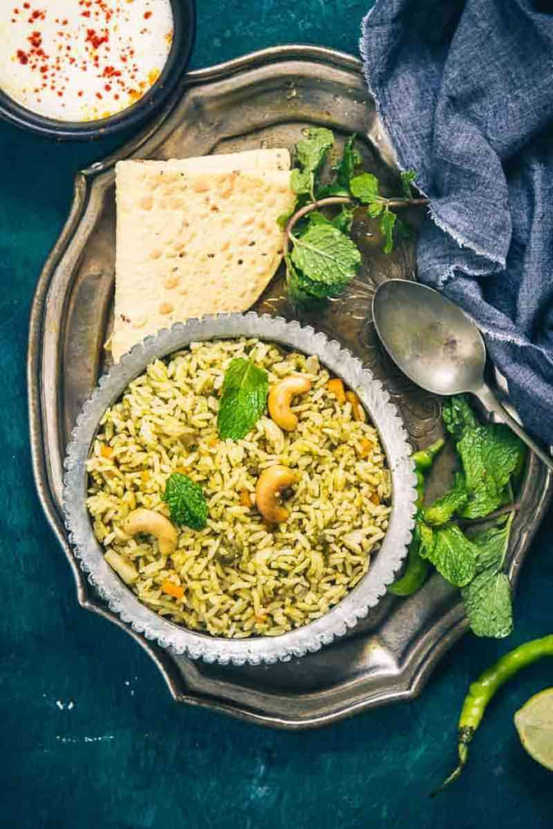 Pudina Pulao or Mint Pulao is a South Indian Style rice recipe made using fresh mint leaves and spices. You can pair it with a raita or curry.